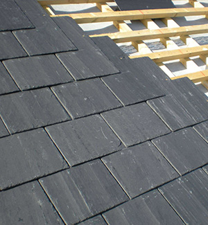 Part way through a slate roof in Stockport